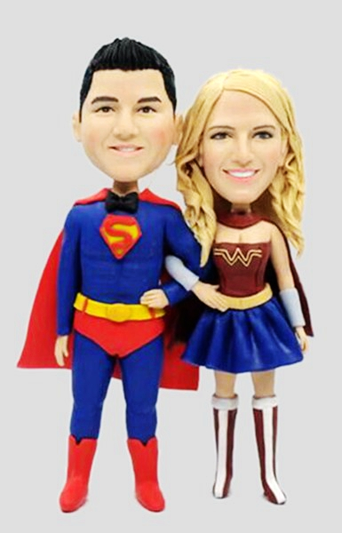 Custom Superman groom and wonderwoman bride cake topper