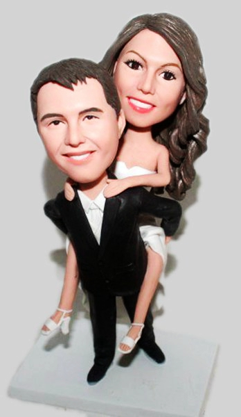 Custom Groom carring bride Custom wedding bobbleheads